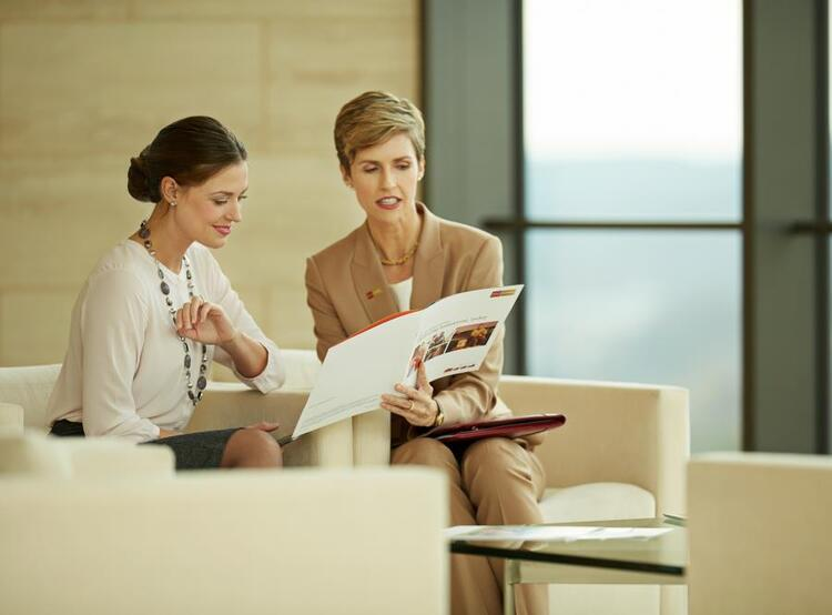 female financial advisor consulting with client