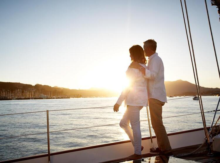 couple on boat at sunset