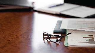 glasses and papers on a desk