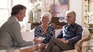 financial advisor consulting with a couple