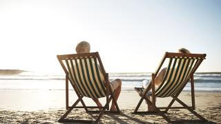 couple in beach chairs on beach